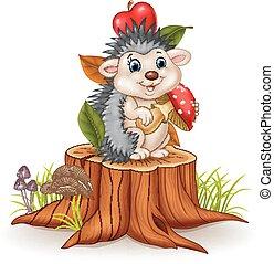 Little hedgehog holding mushroom