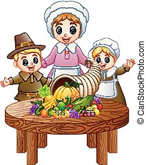 Pilgrim family with cornucopia of fruits and vegetables on round wooden table