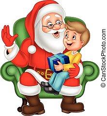 Santa Claus sitting with a little cute boy