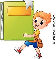 School boy holding a giant book