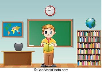School boy reading a book in classroom