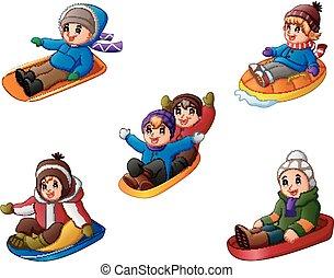 Set of cute children sledding