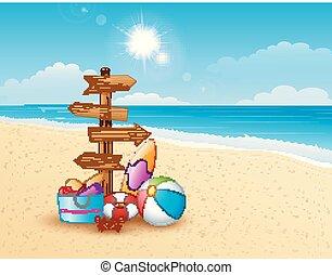 Summer beach with wooden arrow