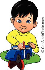 Young boy playing car toy