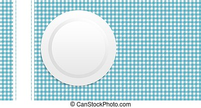white plate on blue tablecloth
