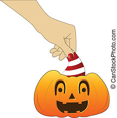 hand with funny pumpkin