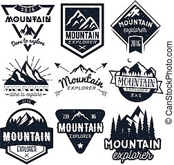 Vector set of mountain labels in vintage style. Design elements, icons, logo, emblems and badges isolated on white background