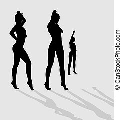 Vector silhouettes of three sexy female on gray background with shadows.