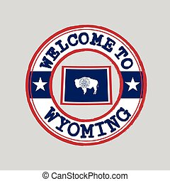 Vector stamp of welcome to Wyoming with map outline of the nation in center.