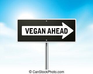 vegan ahead on black road sign