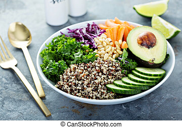 Vegan bowl with fresh vegetables, avocado and quinoa