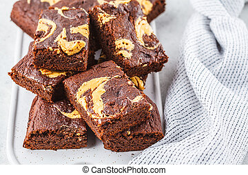 Vegan brownie with peanut butter on white background.