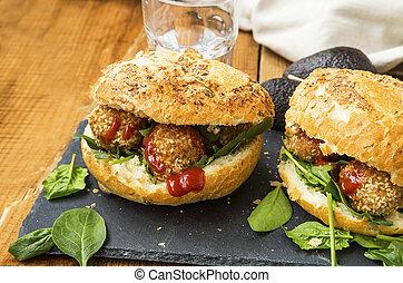 Vegan burgers with chickpeas balls falafel, salad and ketchup
