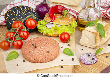 Vegan cuisine - Cooking ingredients for vegan burgers on a...