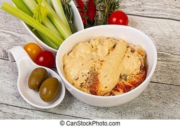 Vegan cuisine - Humus with celery sticks