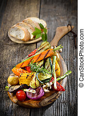 Vegan cuisine - Vegan barbecue: Mixed grilled vegetables on...