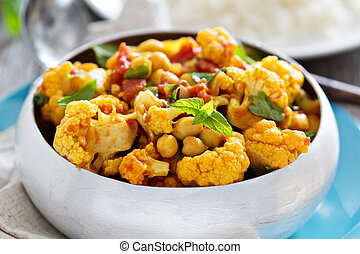 Vegan curry with chickpeas and vegetables - Vegan curry with...