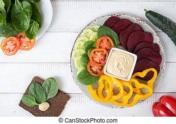 Vegan Food - Flat lay of raw vegan food and hummus.
