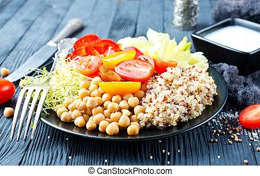 vegan food, vegetables and qinoa on plate