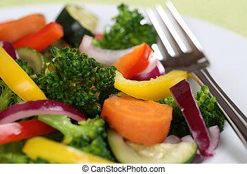 Vegan or vegetarian eating vegetables food on plate -...