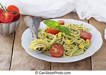 Vegan pasta with avocado sauce, tomatoes and corn