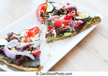 Vegan Pizza - Vegan version of pizza served on a sprouted...