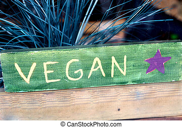 vegan sign - A sign advertising vegan food in a shop window