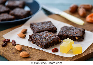 Vegan sweets. Brownies with almonds and agar jelly cubes...