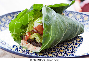 Vegan Taco Wrap - Seasoned nut loaf, guacamole, romaine ...