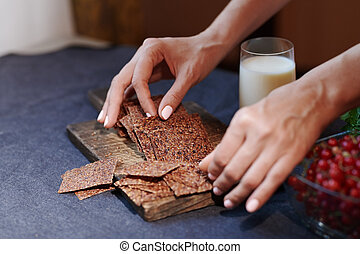 Vegan woman serving flaxseed bread