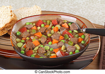 Vegetable beef soup in a brown bowl