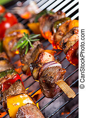 Vegetable and meat skewer on grill