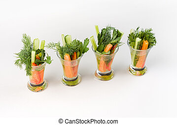 Vegetable appetizer with carrots and cucumber to buffet on a white background