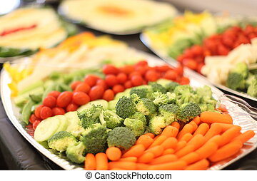 Vegetable appetizers on a tray.