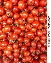 Vegetable background, texture, ripe red tomatoes in supermarket