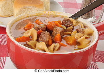 Vegetable beef soup - A bowl of vegetable beef soup with...