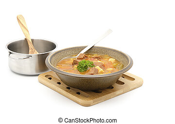 Hearty bowl of homestyle vegetable beef soup on a white background.