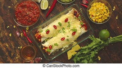 Vegetable Burritos served in glass heatproof dish. With ...