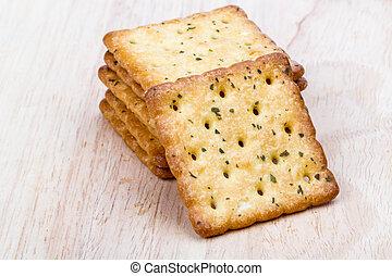 Vegetable cracker on wooden background