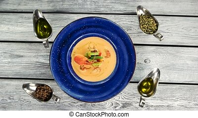 Vegetable cream soup with crayfish. Delicious food on wooden...