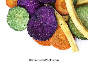 Vegetable crisps, isolated. Healthy snack food.