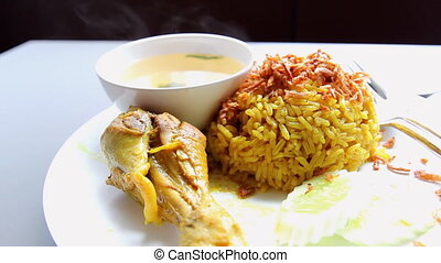 vegetable curry with pilau rice on white background