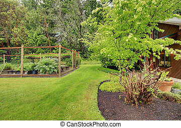 Vegetable Fenced Garden And House