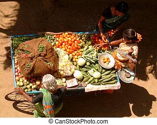 vegetable market - lady selling her vegetables on her...