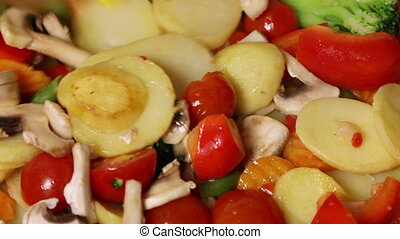 Vegetable mixture with mushrooms fried in a pan and stirred...