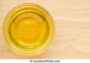 Vegetable oil in glass cup. - Vegetable oil in glass cup on ...
