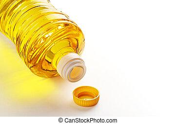 Vegetable oil in plastic bottle on white background
