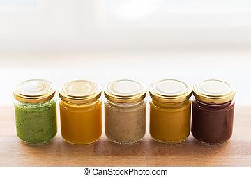 vegetable or fruit puree or baby food in jars