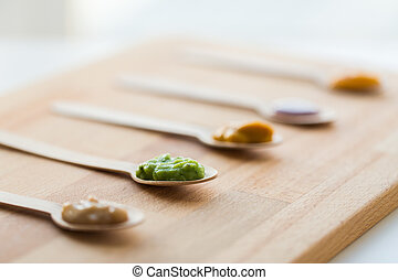 vegetable or fruit puree or baby food in spoons