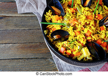Vegetable paella with seafood, top view